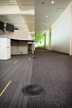 Interface Carpet Tiles installed over access floor with the TacTile installation System